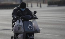Trasporto cibo in scooter a Pechino