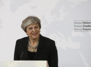May proposes Brexit transitional period in Florence